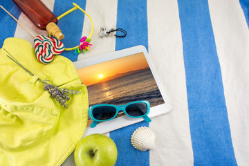 Summer accessories on beach towel