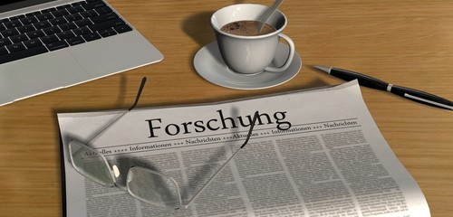 Zeitung auf Schreibtisch - Forschung