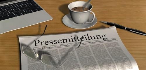 Zeitung auf Schreibtisch - Pressemitteilung