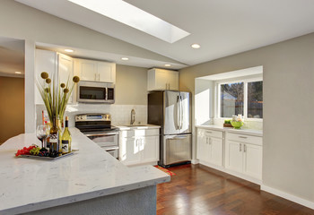 Kitchen room interior with white cabinets, hardwood floor