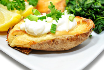 Served Baked Potato with Sour Cream and Scallions