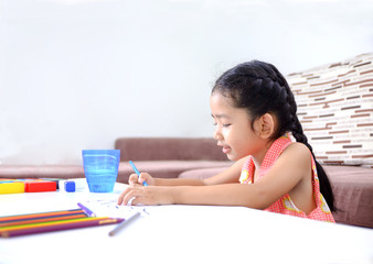 Portrait of cute asian little girl Thai painting the color