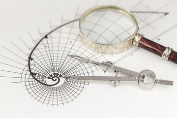 drawing of the golden section, magnifying glass & compass