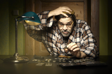 Curmudgeon counting coins at home