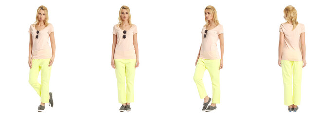 Portrait of young slim woman in yellow pants posing isolated on
