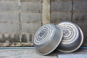 old aluminum basin with concrete background