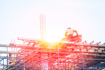 construction worker during reinforcement work with metal rebar rods at building site,Workers are building