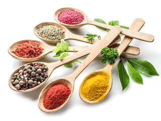 Fotorolgordijn Kruiden Assortment of colorful spices in the wooden spoons on the white