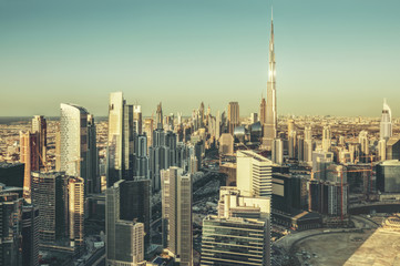 Fantastic architectural background. Panoramic Dubai cityscape with skyscrapers at sunset. Scenic travel background.