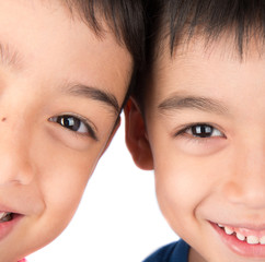 Close up on eyes of sibling brother smiling together