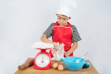 Little boy cooking cake home bakery