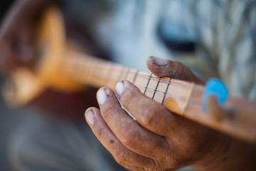 Man playing Tatar instrument