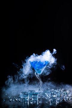 blue cocktail  and ice vapor