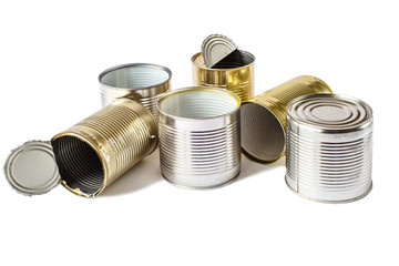 Used metal cans on a white background. Waste management.