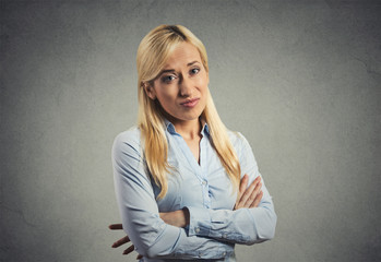 grumpy skeptical blonde woman isolated on gray background