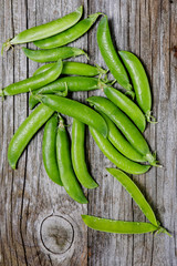 Harvest of beans on the wooden background