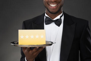 Waiter Holding Plate With Star Rating
