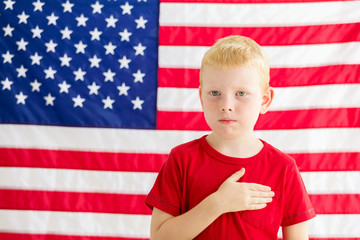 6f05b915ce4 Boy in front of American flag with hand over heart