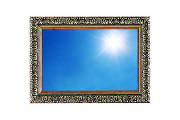 sun shines on blue sky in wooden frame isolated on white