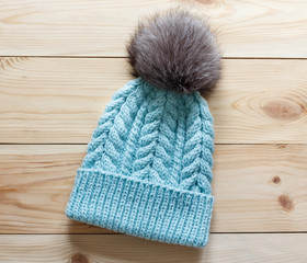 Fashionable handmade knitted hat with natural fluffy fur pompom