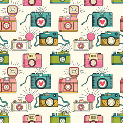 Vector colorful seamless pattern with retro cameras.