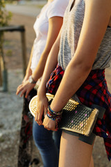 Two teenage girls standing with skateboard