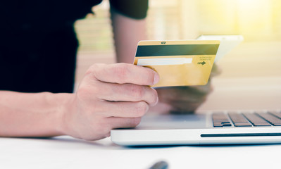 The online shopping card and holding credit card with hand for p