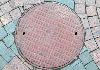Textured metal manhole cover with holes