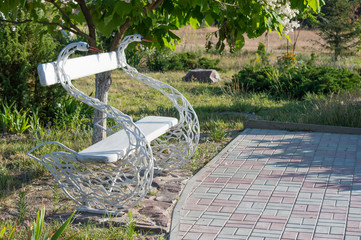 Beautiful bench in the form of white swans.