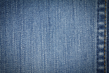 Denim jeans texture or denim jeans background with seam of fashion jeans design with copy space for text or image. Dark edged.
