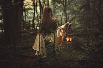 Mysterious woman in fairy forest