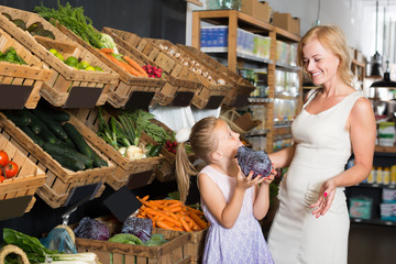Portrait of adult woman and girl gladly shopping