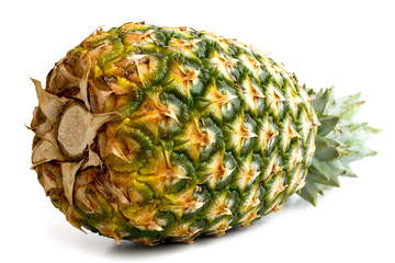 Whole pineapple isolated lying down on white.