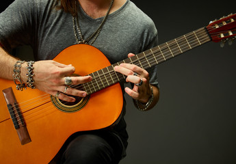 The guy playing an acoustic guitar.