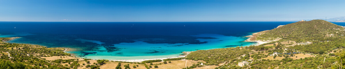 Holidaymakers and turquoise Mediterranean at Bodri beach in Cors