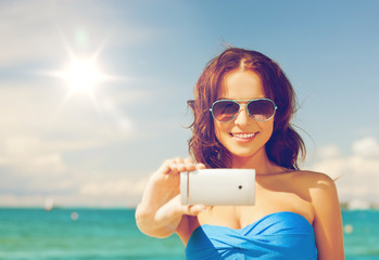woman in bikini with phone