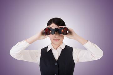 business woman holding a binoculars