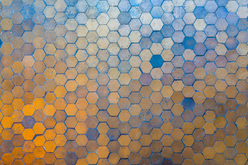 Golden and blue hexagon blocks on the floor. Abstract background