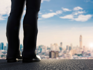 rear view of 3d rendering businessman standing with cityscape background