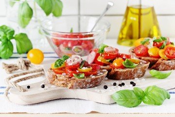 Traditional Italian bruschetta with tomatoes,shallot and basil. Selective focus