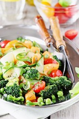 Summer vegetables salad with broccoli,zucchini,carrots,cherry tomatoes and green pea. Clean eating concept.Selective focus