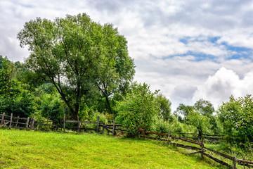 fence on hillside meadow in rural area