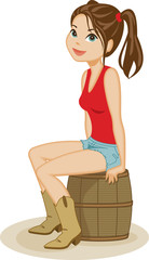 Cute country girl wearing cowboy boots and cut-off denim shorts sits on barrel