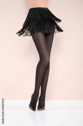 612be9d52ce Beautiful female legs in thick black tights