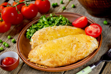Chicken chop cutlet or schnitzel with cheese and green salad