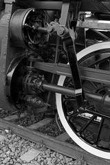 Black and white detail and close up of huge wheels at one old st