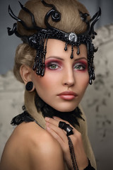 Beautiful girl with a gothic image