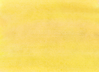 The texture of a sheet of paper painted with yellow paint