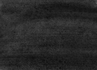 The texture of a sheet of paper painted with black paint