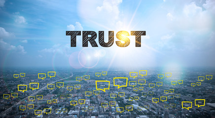 TRUST  text on city and sky background with bubble chat